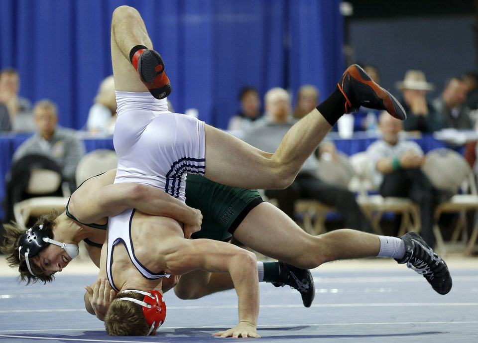 Photo - Norman North's Levi Berry , left, wrestles Brannon Hunt of Ponca City during the Class 6A 160-pound championship match during the state wrestling championships at the State Fair Arena in Oklahoma City, Saturday, Feb. 23, 2013. Photo by Bryan Terry, The Oklahoman