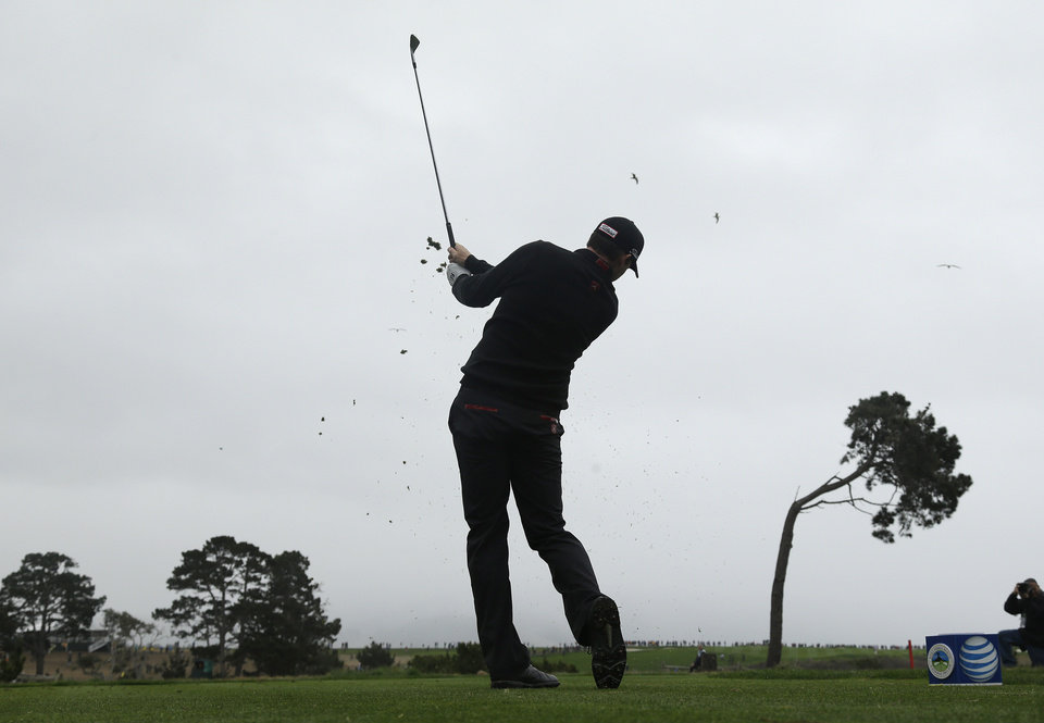 Photo - Jimmy Walker hits from the fifth tee during the final round of the AT&T Pebble Beach Pro-Am golf tournament, Sunday, Feb. 9, 2014, in Pebble Beach, Calif. (AP Photo/Eric Risberg)