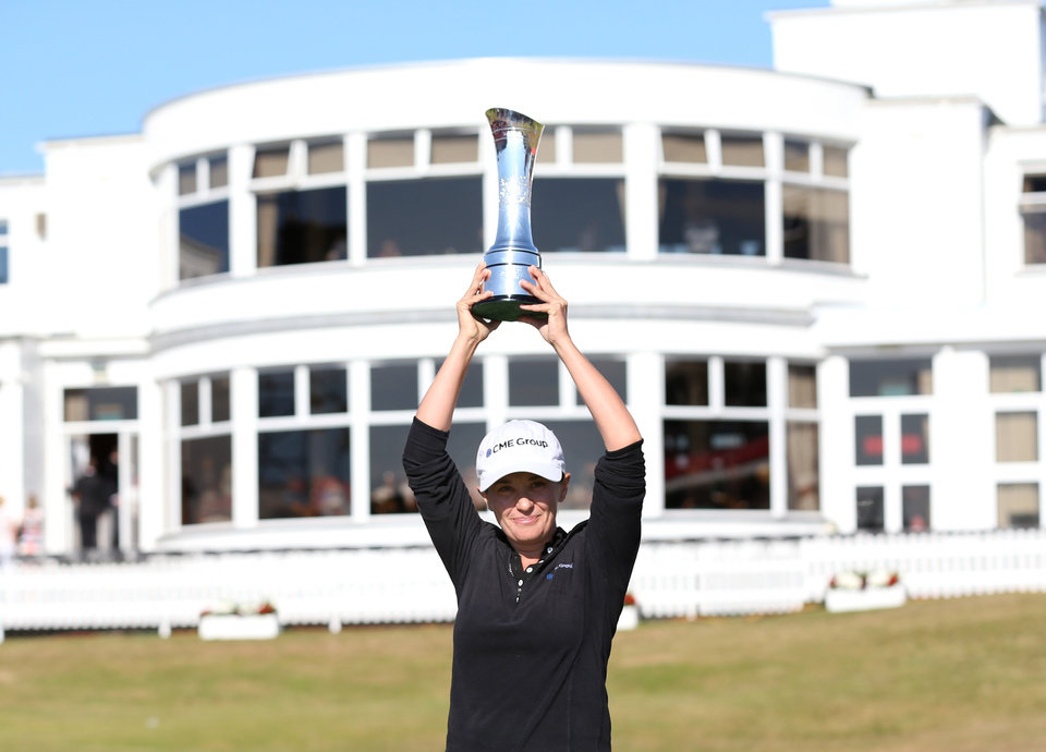 Photo - Mo Martin of the U.S poses with the trophy after winning the Women's British Open golf championship at the Royal Birkdale Golf Club, in Southport, England, Sunday, July 13, 2014. (AP Photo/Scott Heppell)