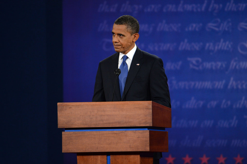 President Barack Obama listens during the first presidential debate with former Massachusetts Governor Mitt Romney at the University of Denver Wednesday, Oct. 3, 2012, in Denver. (AP Photo/The Denver Post, Craig F. Walker) MAGS OUT; TV OUT; INTERNET OUT ORG XMIT: CODEN215
