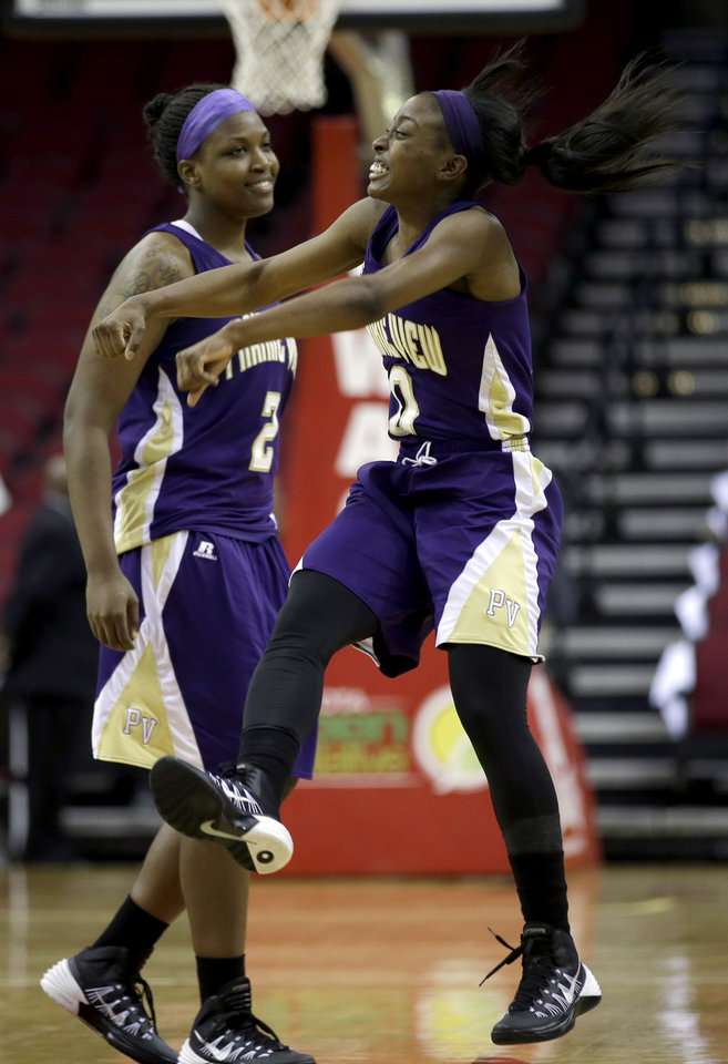 Photo - Prairie View A&M's LaReahn Washington (0) celebrates with teammate Shamiya Brooks (2) after defeating Southern in an NCCA college basketball game in the semifinals of the Southwestern Athletic Conference tournament on Friday, March 14, 2014, in Houston. Prairie View A&M won 72-43. (AP Photo/David J. Phillip)