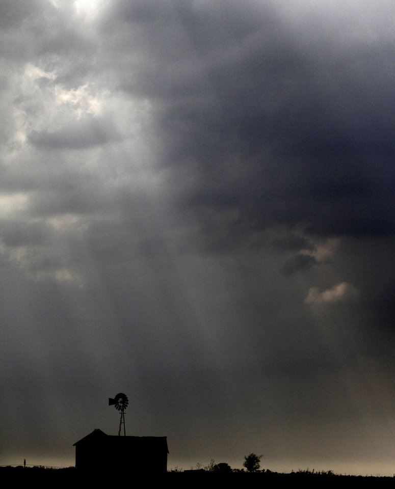Sun rays shine through clouds Tuesday on Piedmont Road near Northwest Expressway as a cold front approaches the Oklahoma City area.  Photo By Steve Gooch, The Oklahoman