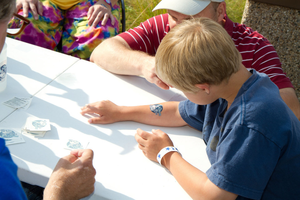 Photo - 9-year-old Reis Wathen gets a temporary tattoo at the Oklahoma City Zoo. at the Oklahoma City Zoo Friday, June 1, 2012. Photo by Steven Maupin, for The Oklahoman