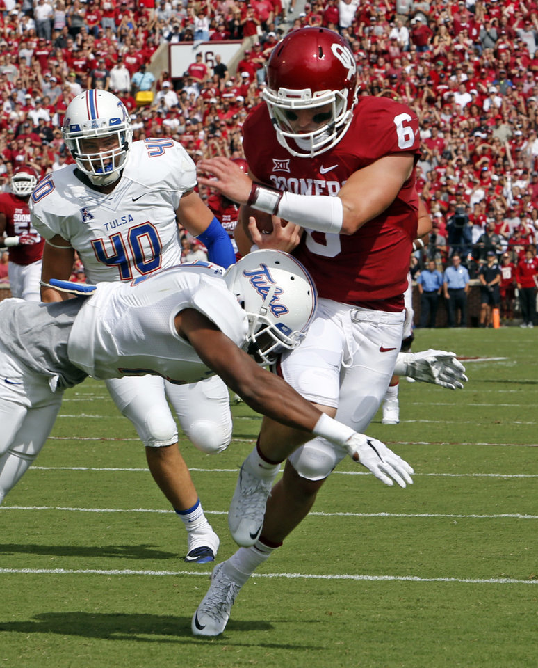 Photo - Oklahoma's Baker Mayfield (6) scrambles for a touchdown in the first quarter during a college football game between the University of Oklahoma Sooners (OU) and the Tulsa Golden Hurricane (TU) at Gaylord Family-Oklahoma Memorial Stadium in Norman, Okla., on Saturday, Sept. 19, 2015. Photo by Steve Sisney, The Oklahoman