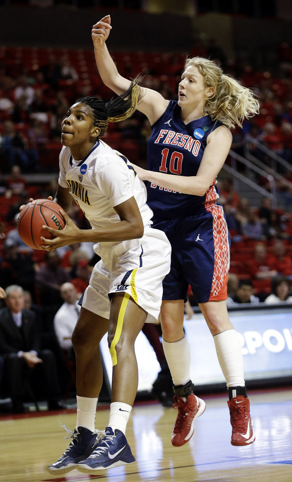 Photo - California forward Reshanda Gray (21) drives past Fresno State forward Alex Sheedy (10) during the first half of a first-round game in the women's NCAA college basketball tournament in Lubbock, Texas, Saturday, March 23, 2013. (AP Photo/LM Otero)