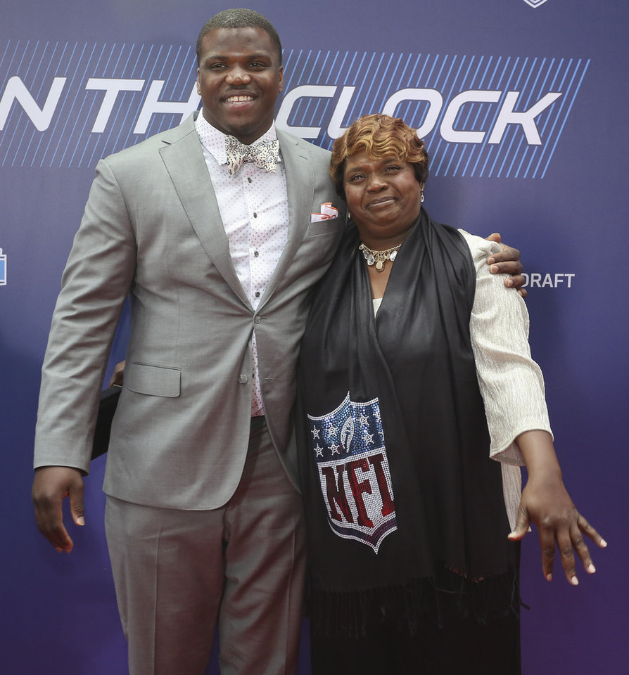 Photo - Auburn outside tackle Greg Robinson poses for photos with his mother, Rhonda Robinson as they arrive for the first round of the 2014 NFL Draft at Radio City Music Hall, Thursday, May 8, 2014, in New York. (AP Photo/Craig Ruttle)