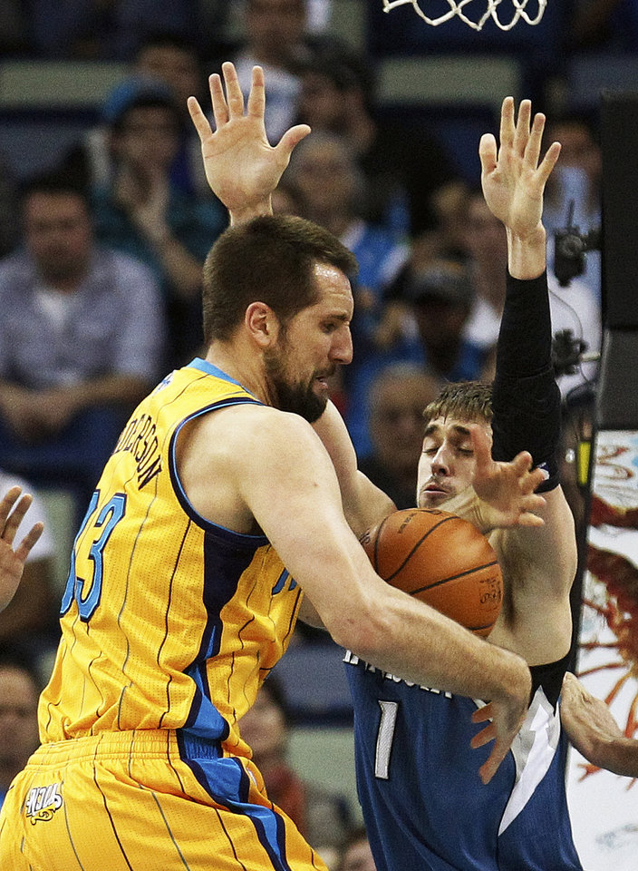 Photo - New Orleans Hornets forward Ryan Anderson (33) loses the ball as Minnesota Timberwolves guard Alexey Shved (1) defends in the first half of an NBA basketball game in New Orleans, Friday, Jan. 11, 2013. (AP Photo/Bill Haber)