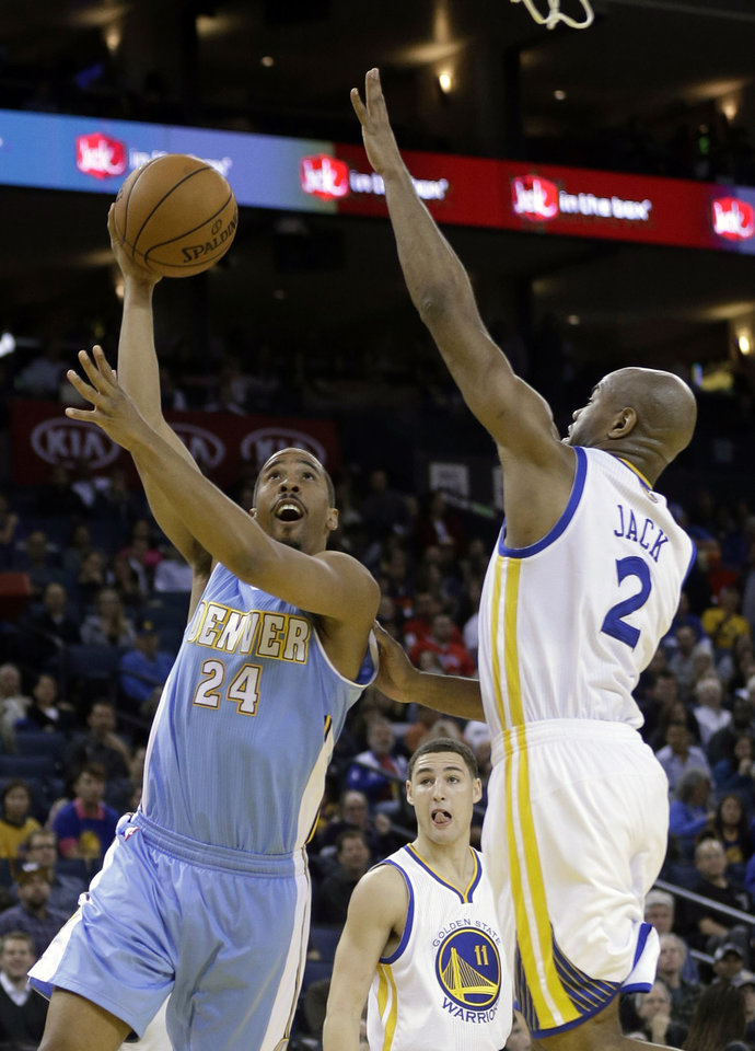 Denver Nuggets' Andre Miller (24) shoots past Golden State Warriors' Jarrett Jack (2) during the first half of an NBA basketball game in Oakland, Calif., Thursday, Nov. 29, 2012. (AP Photo/Marcio Jose Sanchez)
