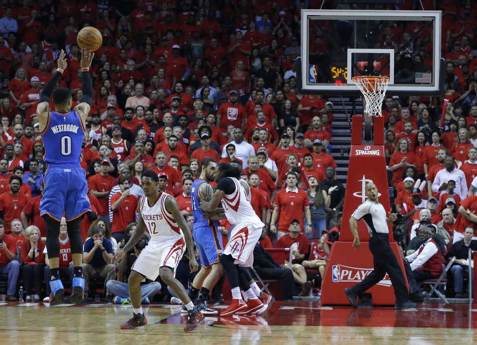 Photo - Oklahoma City's Russell Westbrook (0) shoots in the fourth quarter during Game 5 in the first round of the NBA playoffs between the Oklahoma City Thunder and the Houston Rockets in Houston, Texas,  Tuesday, April 25, 2017.  Houston won 105-99. Photo by Sarah Phipps, The Oklahoman