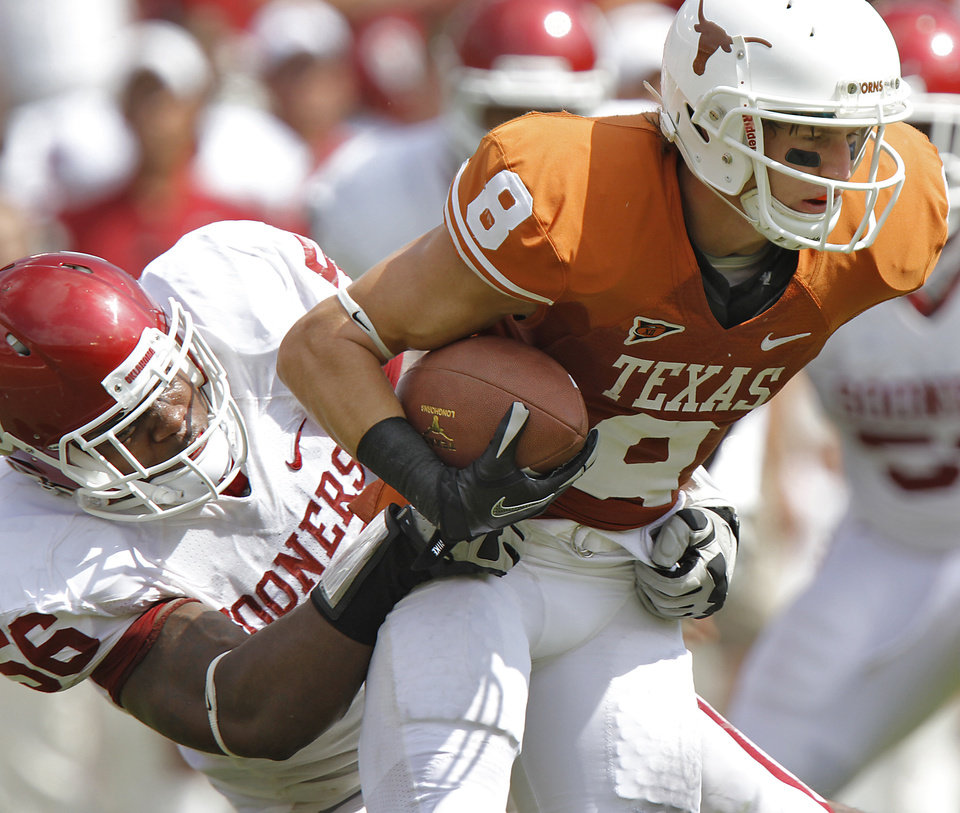 Photo - Oklahoma's Ronnell Lewis (56) brings down Jaxon Shipley (8) Texas' during the Red River Rivalry college football game between the University of Oklahoma Sooners (OU) and the University of Texas Longhorns (UT) at the Cotton Bowl in Dallas, Saturday, Oct. 8, 2011. Photo by Chris Landsberger, The Oklahoman