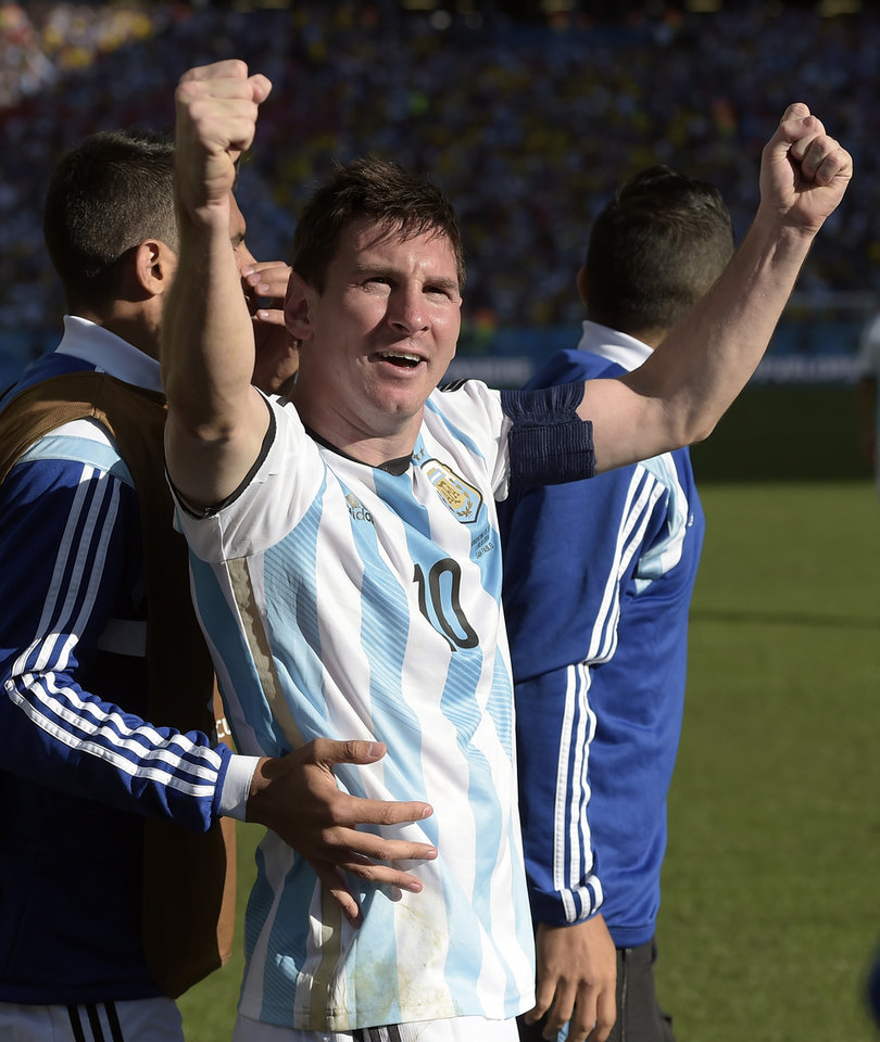 Photo - Argentina's Lionel Messi celebrates after Angel di Maria scored his side's only and winning goal in extra time during the World Cup round of 16 soccer match between Argentina and Switzerland at the Itaquerao Stadium in Sao Paulo, Brazil, Tuesday, July 1, 2014. Argentina defeated Switzerland 1-0 to move on to the quarterfinals. (AP Photo/Manu Fernandez)