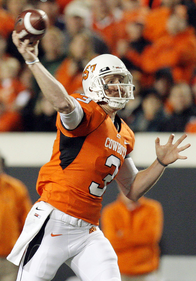 Photo - OSU's Brandon Weeden (3) throws a pass in the first quarter during the Bedlam college football game between the University of Oklahoma Sooners (OU) and the Oklahoma State University Cowboys (OSU) at Boone Pickens Stadium in Stillwater, Okla., Saturday, Nov. 27, 2010. Photo by Nate Billings, The Oklahoman