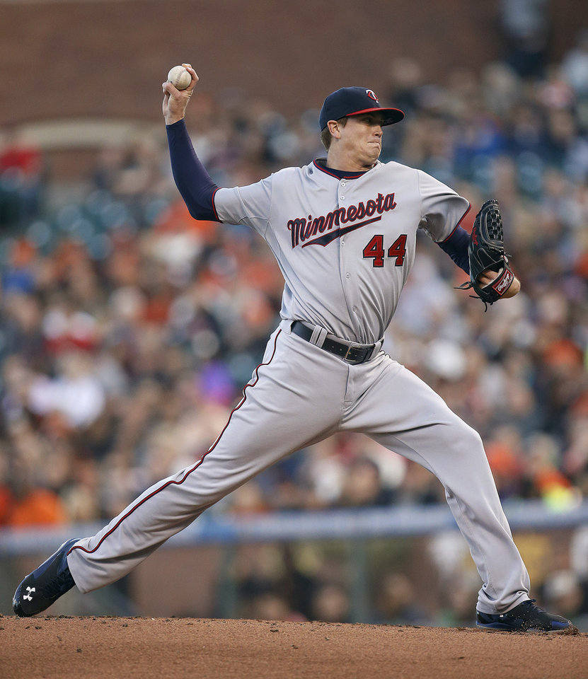 Photo - Minnesota Twins starting pitcher Kyle Gibson throws against the San Francisco Giants in the first inning of a baseball game Friday, May 23, 2014, in San Francisco. (AP Photo/Tony Avelar)