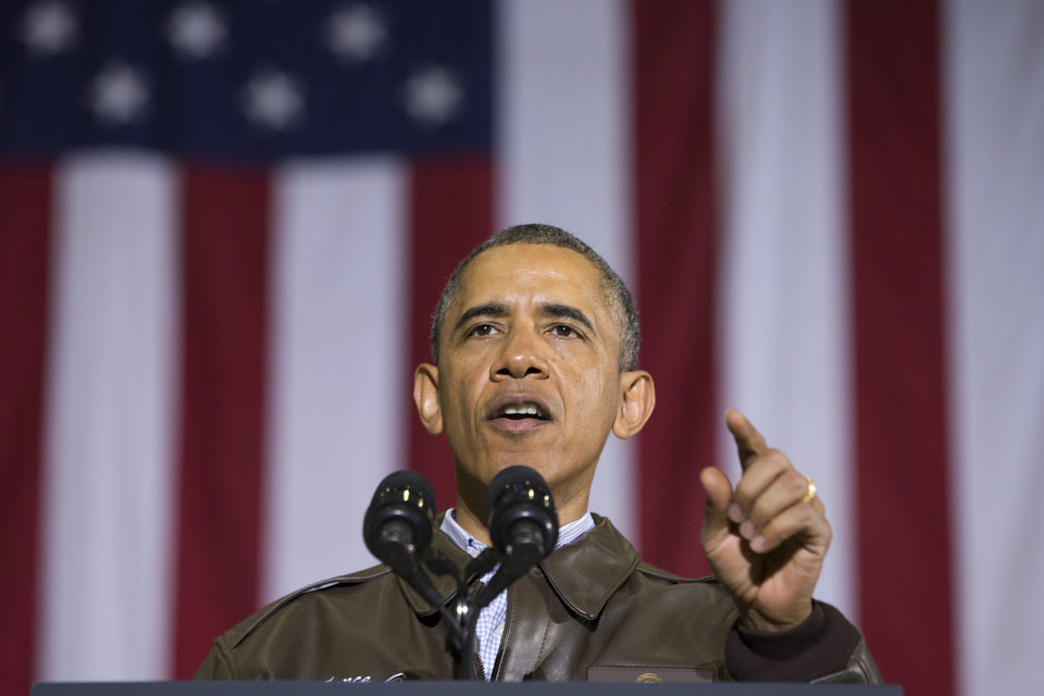 Photo - President Barack Obama gestures while speaking to troops at Bagram Air Field north of Kabul, Afghanistan, during an unannounced visit, on Sunday, May 25, 2014. (AP Photo/ Evan Vucci)