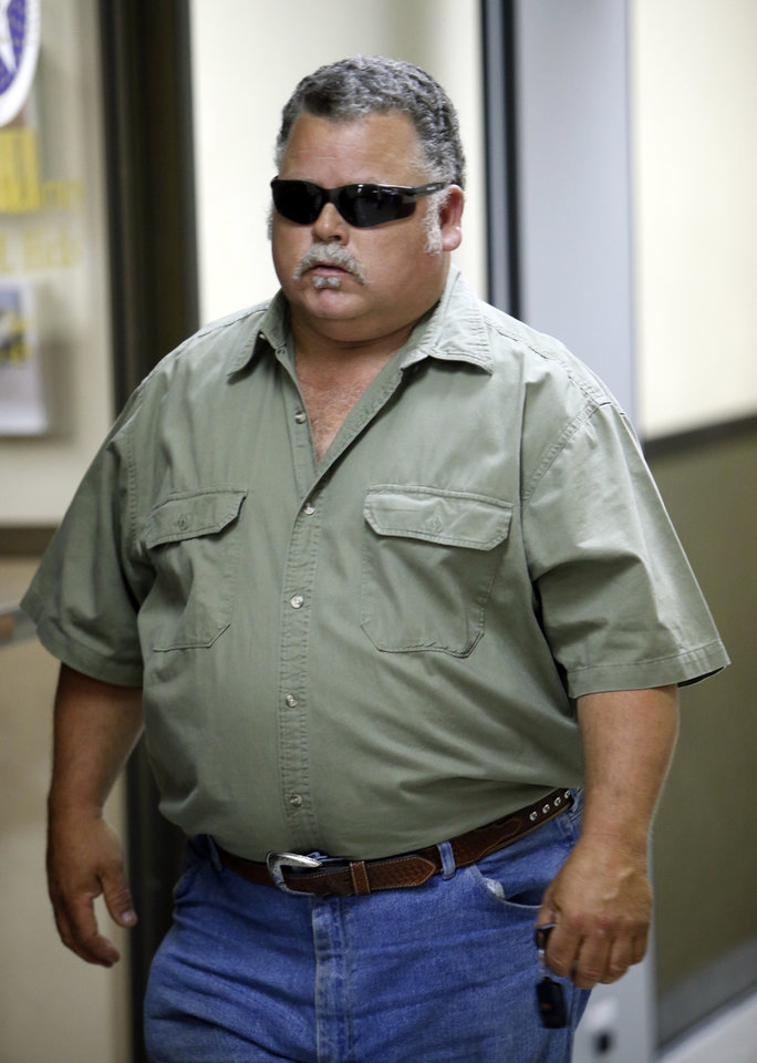 CHRISTOPHER LANE MURDER / MICHAEL JONES: The father of Michael Dewayne Jones, 17, one of three teenage suspects in the shooting death of Christopher Lane leaves the courtroom after their arraigned on Tuesday, Aug. 20, 2013 in Duncan, Okla.  Photo by Steve Sisney, The Oklahoman