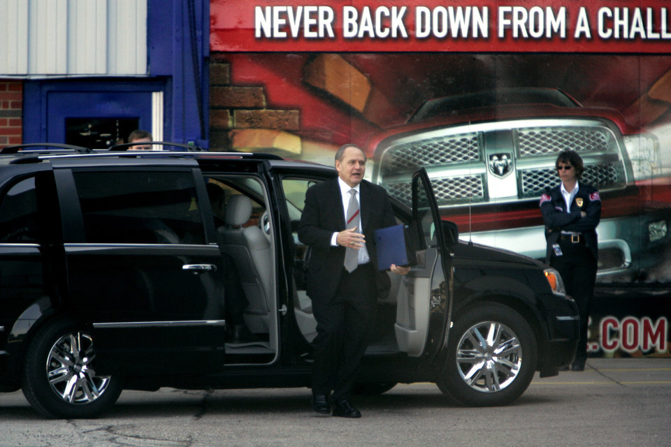 Photo -   In this photo taken March 9, 2009, Chrysler Chairman and chief executive Bob Nardelli arrives for a meeting with members of the Obama administration's auto task force at the automaker's Warren Truck Assembly in Warren, Mich. The task force met with General Motors Corp. executives earlier in the day. The government bailout of General Motors and Chrysler is one of the most polarizing issues of the presidential campaign. Many Americans wonder why $62 billion in tax dollars went to keeping the two automakers afloat in 2008 and 2009. There's little doubt the bailout saved the automakers and huge numbers of jobs. But there's also little chance the government will get all its money back. (AP Photo/Carlos Osorio)