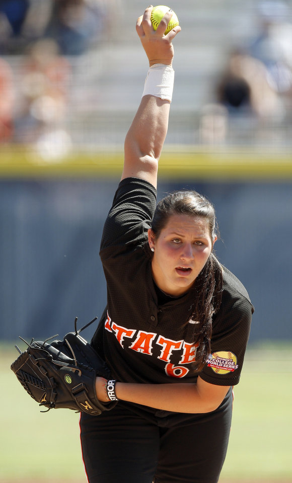 Photo - Oklahoma State's Kat Espinosa (6) pitches during a Women's College World Series softball game between Oklahoma State University and California at ASA Hall of Fame Stadium in Oklahoma City, Saturday, June 4, 2011. Photo by Bryan Terry, The Oklahoman