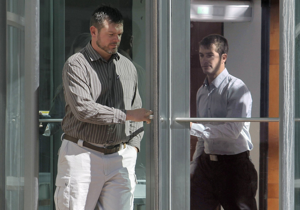 Photo - FILE - In this Oct. 22, 2013 file photo, Eric Jensen, 37, left, and Ryan Jensen, 33, leave the federal courthouse in Denver. On Tuesday, Jan. 28, 2014, the two Colorado cantaloupe farmers who pleaded guilty to charges stemming from a deadly listeria outbreak in 2011 are scheduled to be sentenced. The brothers, who owned and operated Jensen Farms in Holly, face up to six years in prison and $1.5 million in fines. The outbreak was traced to tainted fruit from the farm, causing 33 deaths and sending scores of people to hospitals. (AP Photo/Ed Andrieski, File)