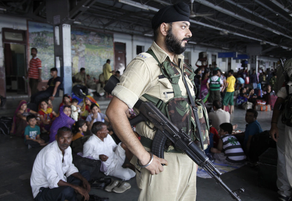 Photo - A security officer keeps vigil at a railway station in Jammu, india, Thursday, July 3, 2014. Security has been beefed up ahead of Indian prime minister Narendra Modi's visit to the state of Jammu and Kashmir, Police said. (AP Photo/Channi Anand)