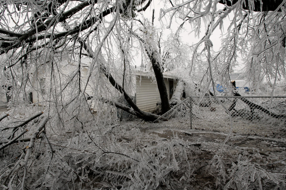 WINTER / COLD / WEATHER / ICE STORM 2007: Damage from downed trees during a winter storm, in Carney, Okla., Tuesday, December 11, 2007. By Matt Strasen, The Oklahoman ORG XMIT: KOD