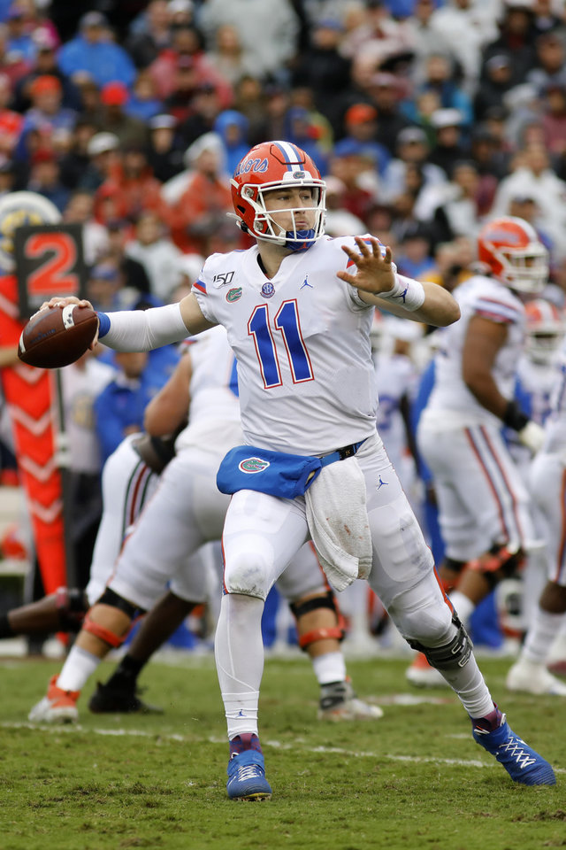 Photo - Florida's Kyle Trask throws a pass against South Carolina in the second half of an NCAA college football game Saturday, Oct. 19, 2019, in Columbia, SC. Florida defeated South Carolina 38-27. (AP Photo/Mic Smith)