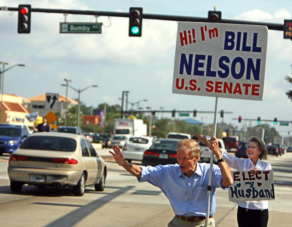 U.S. Sen. Bill Nelson, D-Fla., front, and his wife Grace Nelson campaign at the intersection of Colonial Drive an Bumby Avenue, Monday, Nov. 5, 2012 in Orlando, Fla. (AP Photo/The Tampa Bay Times, Scott Keeler)