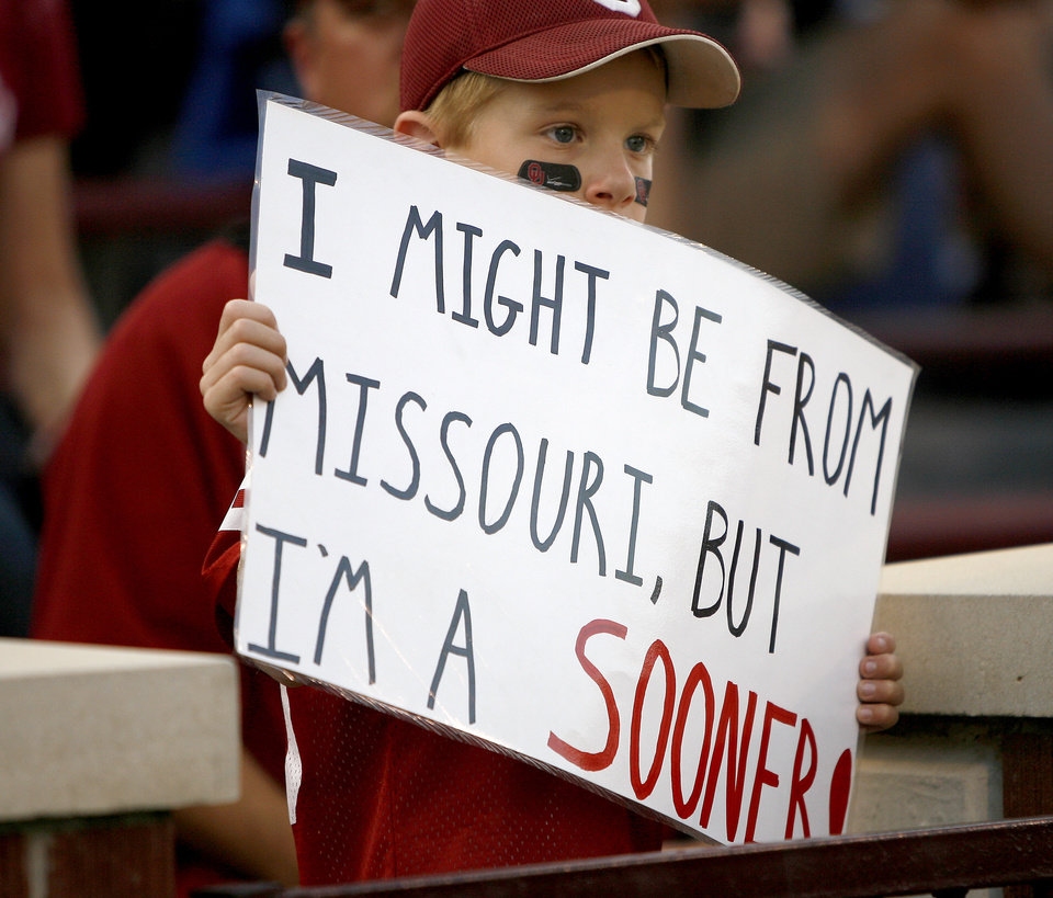 Photo - Hunter McKinney, 8, from Houston, Missouri, watches the OU-Mizzou game on Saturday in Norman. Photo by Bryan Terry, The Oklahoman