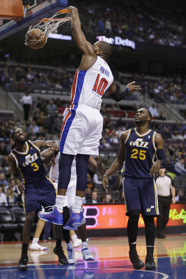 Detroit Pistons center Greg Monroe (10) dunks during the first quarter of an NBA basketball game against the Utah Jazz at the Palace of Auburn Hills, Mich., Saturday, Jan. 12, 2013. (AP Photo/Carlos Osorio)