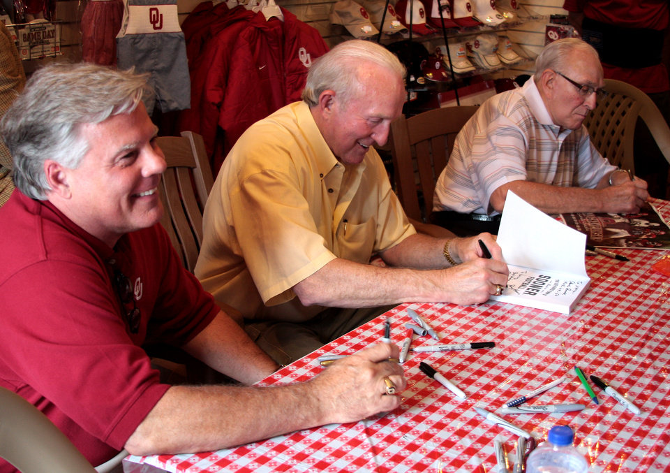 Photo - From left, Steve Davis, Jimmy Harris and Claude Arnold were three of the former OU quarterbacks at Sunday's book signing. - Photo provided by Greg Jackson  ORG XMIT: 0906072354178995