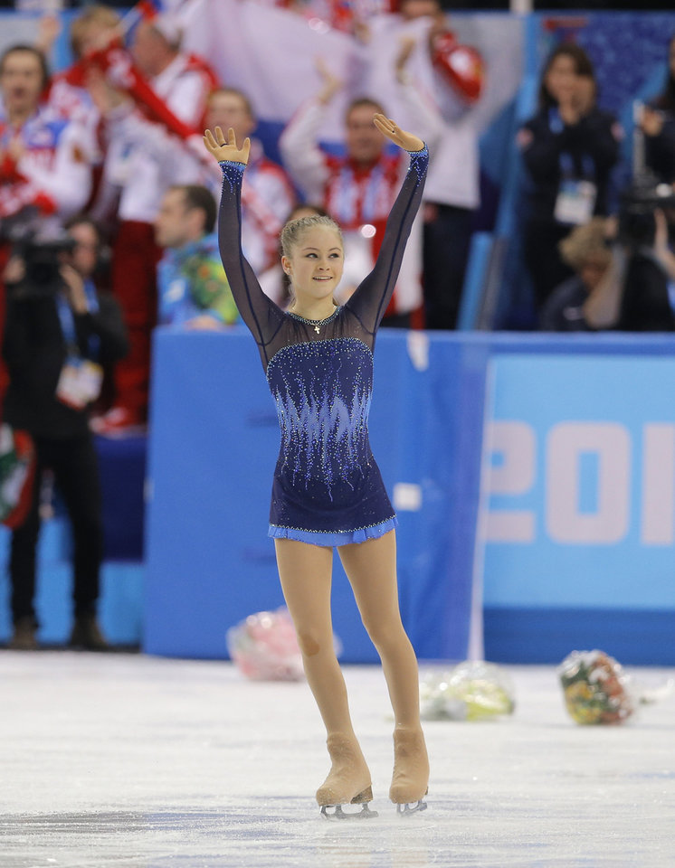 Photo - Yulia Lipnitskaya of Russia waves to spectators after competing in the women's team short program figure skating competition at the Iceberg Skating Palace during the 2014 Winter Olympics, Saturday, Feb. 8, 2014, in Sochi, Russia. (AP Photo/Vadim Ghirda)