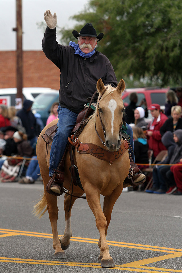 Photo - Former Oklahoma City Blazers coach Doug Sauter rides in the 47th annual Czech Festival parade Saturday in Yukon. PHOTO BY HUGH SCOTT FOR THE OKLAHOMAN