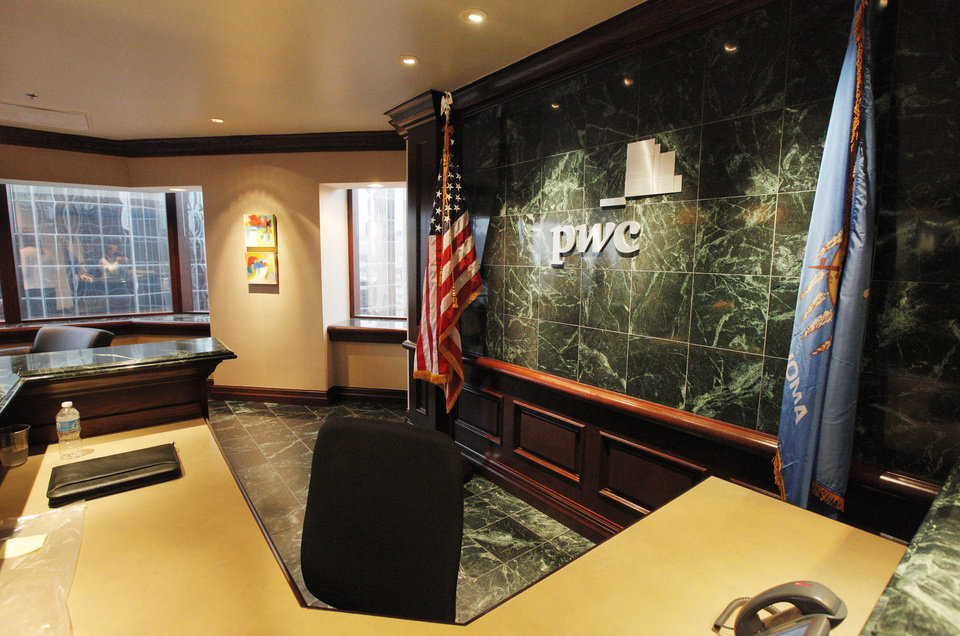 Photo -  Shown are the lobby and reception area of the new PcW office in Suite 1400 of Two Leadership Square, 211 N Robinson Ave. PHOTO BY PAUL B. SOUTHERLAND, THE OKLAHOMAN   PAUL B. SOUTHERLAND -