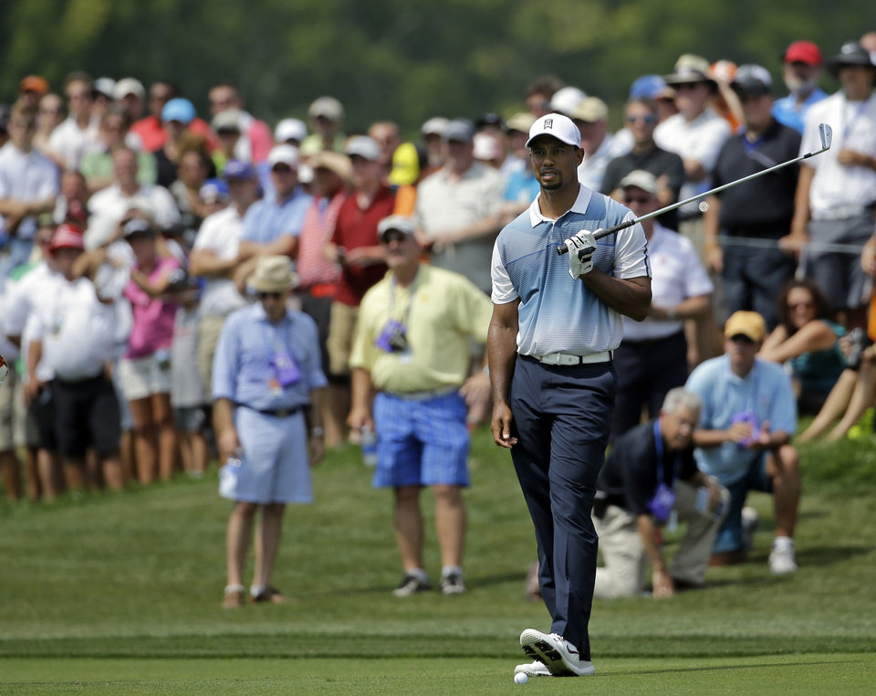 Photo - Tiger Woods watches his shot from the fairway on the sixth hole during a practice round for the PGA Championship golf tournament at Valhalla Golf Club on Wednesday, Aug. 6, 2014, in Louisville, Ky. The tournament is set to begin on Thursday. (AP Photo/Jeff Roberson)