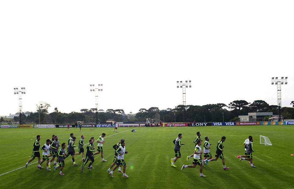 Photo - Spanish national team players train at the Atletico Paranaense training center in Curitiba, Brazil, Monday, June 9, 2014. Spain will play in group B of the Brazil 2014 World Cup. (AP Photo/Manu Fernandez)