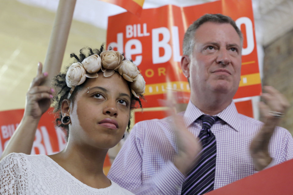 Photo - Democratic mayoral hopeful Bill de Blasio, right, is joined by his daughter Chiara, during a campaign rally in the Brooklyn borough of New York, Saturday, Sept. 7, 2013. The Democratic primary election is Tuesday, Sept. 10. (AP Photo/Mary Altaffer)
