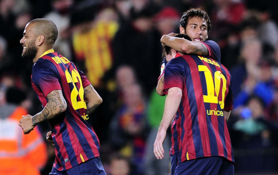 Photo - FC Barcelona's Lionel Messi, from Argentina, second left, reacts after scoring with his teammate Neymar, from Brazil, against Almeria during a Spanish La Liga soccer match at the Camp Nou stadium in Barcelona, Spain, Sunday, March 2, 2014. (AP Photo/Manu Fernandez)