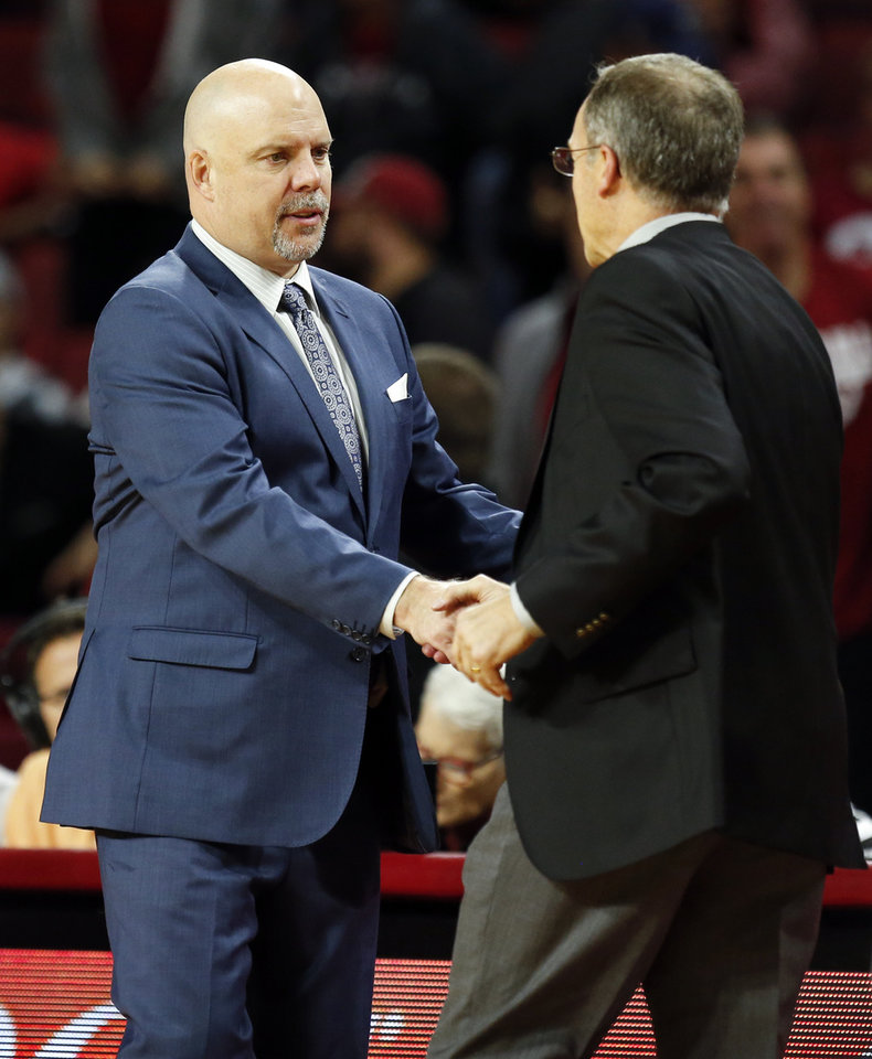Photo - UTSA head coach Steve Henson, left, shakes hands with OU head coach Lon Kruger after a men's college basketball game between the Oklahoma Sooners (OU) and the University of Texas at San Antonio Roadrunners (UTSA) at the Lloyd Noble Center in Norman, Okla., Monday, Dec. 4, 2017. OU won 97-85. Photo by Nate Billings, The Oklahoman