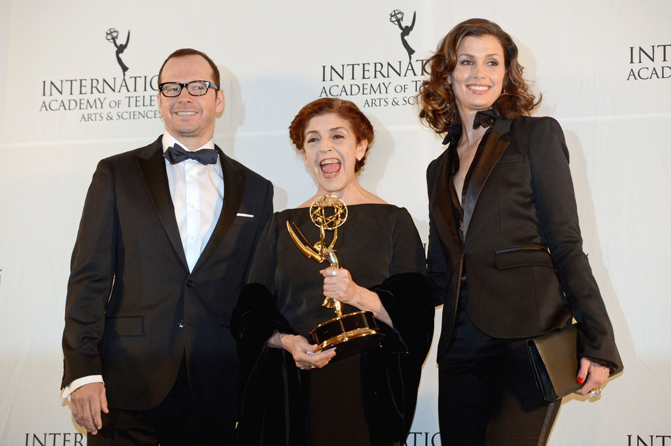 Photo -   Argentine actress Cristina Banegas, center, poses with presenters Donnie Wahlberg, left, and Bridget Moynihan after winning the Best Performance by an Actress award for her role in the miniseries