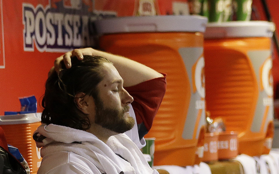 Photo -   St. Louis Cardinals starting pitcher Lance Lynn reacts in the dugout after being taken out of the game in the fourth inning of Game 5 of baseball's National League championship series against the San Francisco Giants, Friday, Oct. 19, 2012, in St. Louis. (AP Photo/David J. Phillip)