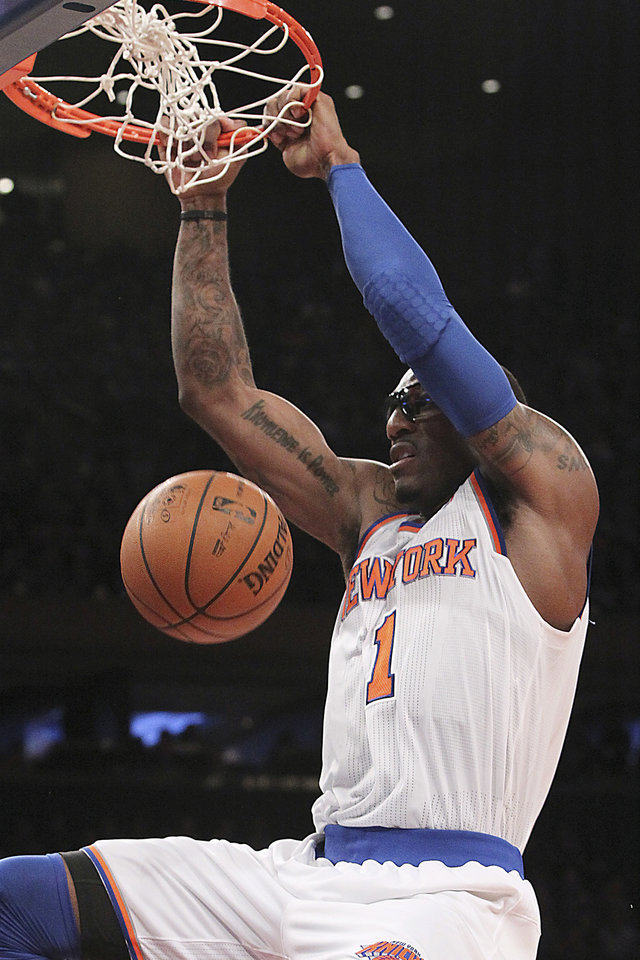 New York Knicks\' Amare Stoudemire dunks during the first half of NBA basketball game against the Sacramento Kings, Saturday, Feb. 2, 2013, at Madison Square Garden in New York. (AP Photo/Mary Altaffer)