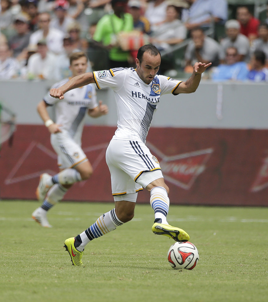 Photo - In this Saturday, Aug. 2, 2014 photo, Los Angeles Galaxy's Landon Donovan controls the ball during the second half of an MLS soccer match against Portland Timers in Carson, Calif. Donovan says he will retire from professional soccer at the end of the MLS season. (AP Photo/Jae C. Hong)