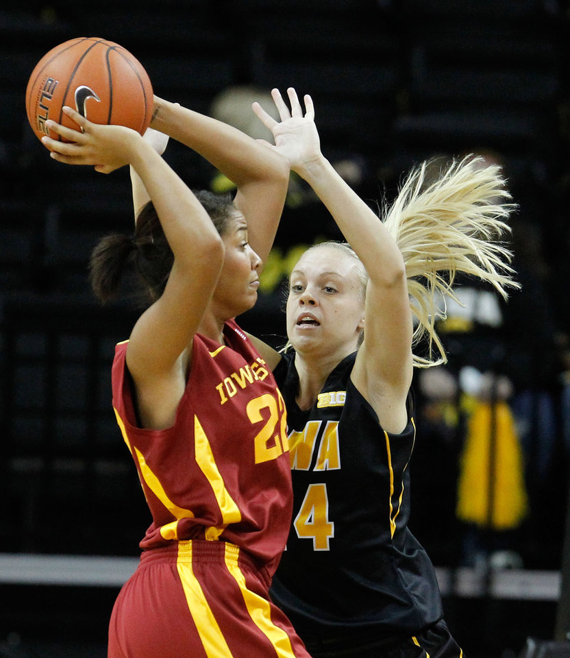 Photo - Iowa State forward Brynn Williamson (22) looks to pass around Iowa guard Jaime Printy (24) during the first half an NCAA college basketball game Thursday, Dec. 6, 2012 at Carver-Hawkeye Arena in Iowa City, Iowa.  (AP Photo/The Gazette,Brian Ray)