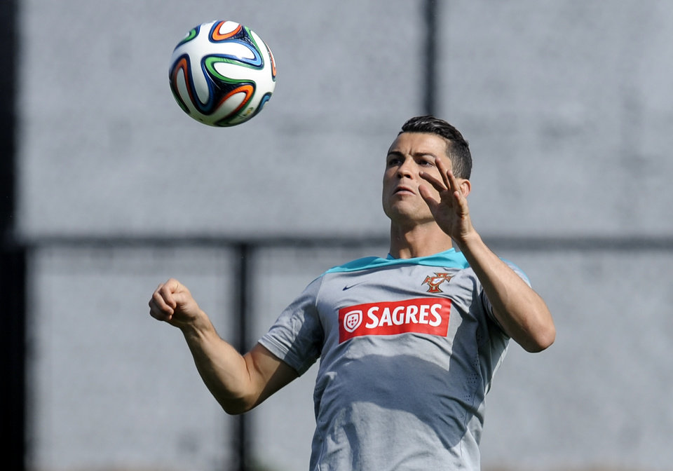 Photo - Cristiano Ronaldo controls the ball during a training session of Portugal in Campinas, Brazil, Thursday, June 19, 2014. Portugal plays in group G of the Brazil 2014 soccer World Cup. (AP Photo/Paulo Duarte)