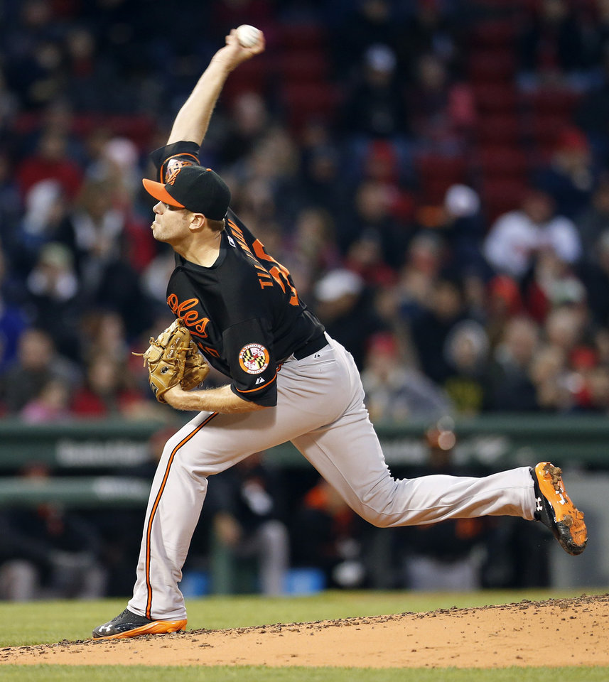 Photo - Baltimore Orioles' Chris Tillman pitches in the first inning of a baseball game against the Boston Red Sox in Boston, Friday, April 18, 2014. (AP Photo/Michael Dwyer)