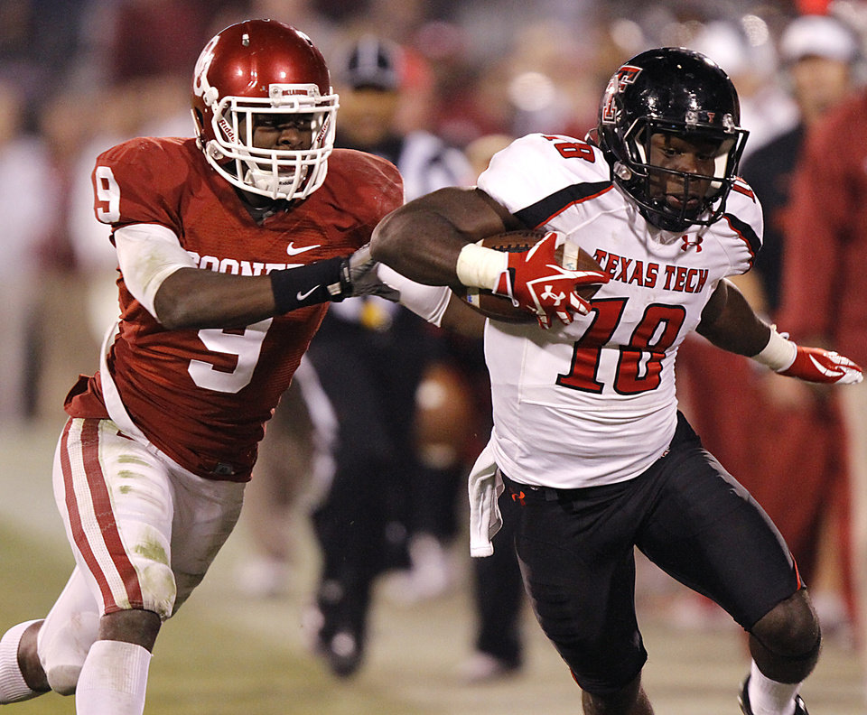 Texas Tech\'s Eric Ward (18) makes a catch in front of Oklahoma\'s Gabe Lynn (9) during the college football game between the University of Oklahoma Sooners (OU) and Texas Tech University Red Raiders (TTU) at the Gaylord Family-Oklahoma Memorial Stadium on Saturday, Oct. 22, 2011. in Norman, Okla. Photo by Chris Landsberger, The Oklahoman