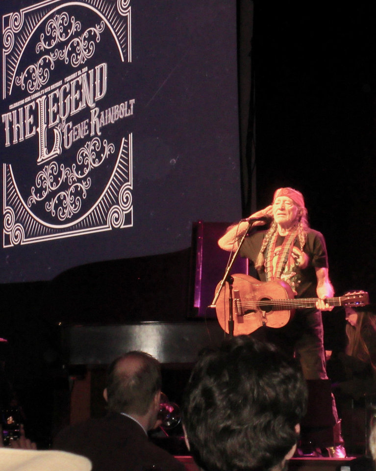 Photo - Willie Nelson encouraging guests to sing his famous songs along with him.  PHOTO BY HELEN FORD WALLACE, THE OKLAHOMAN