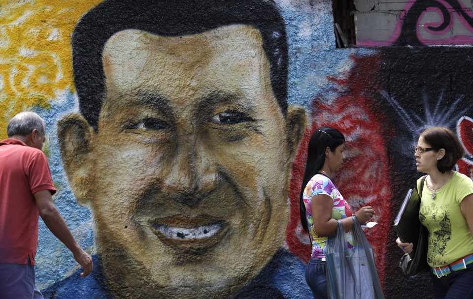 Photo - A mural of Venezuela's President Hugo Chavez decorates a wall in Caracas, Venezuela, Wednesday, Jan. 9, 2013.  Venezuela's congress has voted to postpone the inauguration of President Hugo Chavez, which was scheduled for Thursday, to let him recover from cancer surgery in Cuba. Critics say that violates the country's constitution. On Wednesday, Venezuela's Supreme Court backed the congress, ruling Chavez's inauguration can be postponed. (AP Photo/Ariana Cubillos)