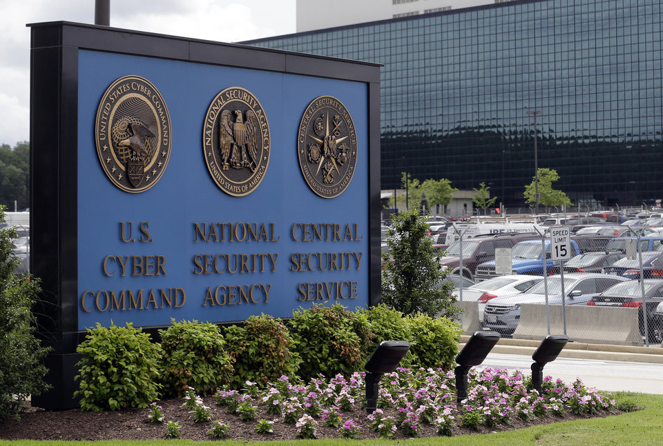 Photo - FILE - This June 6, 2013 file photo shows the sign outside the National Security Agency campus in Fort Meade, Md. The House is poised to take the first significant step to change the National Security Agency's bulk collection of American phone records, a compromise bill that is displeasing many civil liberties activists. The bill, scheduled for a House vote on May 22, 2014, instructs the phone companies to hold the records for 18 months and let the NSA search them in terrorism investigations in response to a judicial order.  (AP Photo/Patrick Semansky, File)