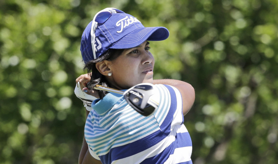 Photo - Julieta Granada, of Paraguay, watches here tee shot on the second hole during the third round of the North Texas LPGA Shootout golf tournament at the Las Colinas Country Club in Irving, Texas, Saturday, May 3, 2014. (AP Photo/LM Otero)