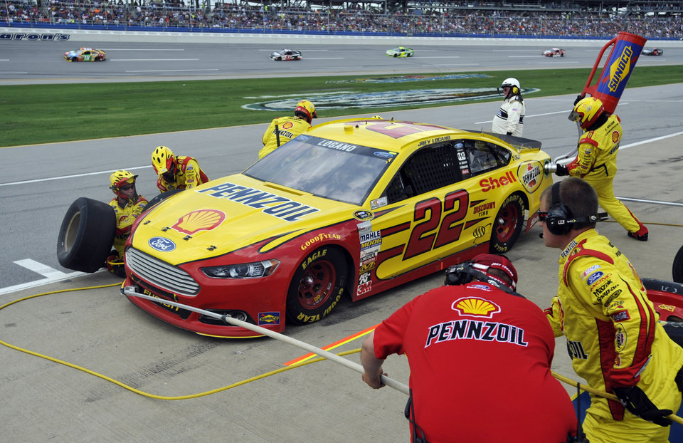 Joey Logano gets service during the NASCAR Sprint Cup Series Aaron's 499 auto race at Talladega Superspeedway in Talladega, Ala., Sunday, May 5, 2013. (AP Photo/Rainier Ehrhardt)
